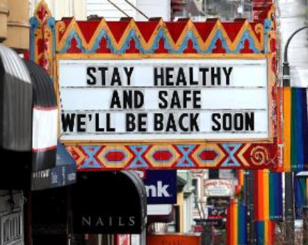 Movie marquee displaying Stay Healthy and Safe, We'll Be Back Soon