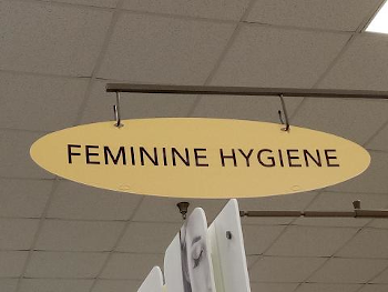 Feminine Hygiene products sign in grocery store