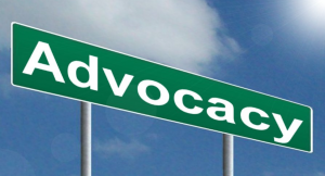 Advocacy Sign for the RPCV-HC one-year anniversary wrap up