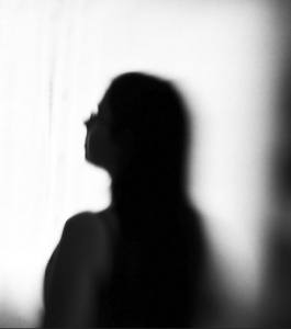 silhouette of a survivor against a light background
